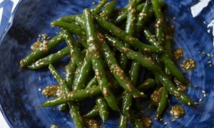 Green beans rolling in toasted sesame seeds
